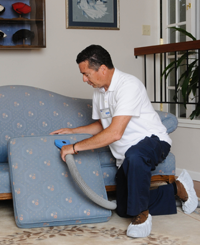 Victor Dominquez, cleaning a couch