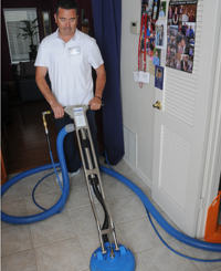 Victor Dominquez, cleaning tile floors